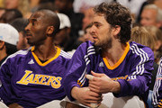 Kobe Bryant #24 and Pau Gasol #16 of the Los Angeles Lakers look on from the bench against the Denver Nuggets at the Pepsi Center on November 11, 2010 in Denver, Colorado. The Nuggets defeated the Lakers 118-112.  NOTE TO USER: User expressly acknowledges and agrees that, by downloading and/or using this Photograph, User is consenting to the terms and conditions of the Getty Images License Agreement.