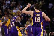 Kobe Bryant #24 of the Los Angeles Lakers and Pau Gasol #16 of the Los Angeles Lakers react during their game against the Golden State Warriors at Oracle Arena on December 22, 2012 in Oakland, California. NOTE TO USER: User expressly acknowledges and agrees that, by downloading and or using this photograph, User is consenting to the terms and conditions of the Getty Images License Agreement.