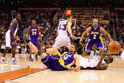 Pau Gasol #16 of the Los Angeles Lakers collides into Amar'e Stoudemire #1 of the Phoenix Suns as Derek Fisher #2 and Steve Nash #13 look on during the NBA game at US Airways Center on December 28, 2009 in Phoenix, Arizona. The Suns defeated the Lakers 118-103. NOTE TO USER: User expressly acknowledges and agrees that, by downloading and or using this photograph, User is consenting to the terms and conditions of the Getty Images License Agreement.