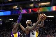 DeMarcus Cousins #15 of the Sacramento Kings goes up for a shot against Julius Randle #30 and Luol Deng #9 of the Los Angeles Lakers at Golden 1 Center on December 12, 2016 in Sacramento, California.  NOTE TO USER: User expressly acknowledges and agrees that, by downloading and or using this photograph, User is consenting to the terms and conditions of the Getty Images License Agreement.