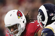Wide receiver Larry Fitzgerald #11 of the Arizona Cardinals runs with the football after a reception against cornerback Trumaine Johnson #22 of the Los Angeles Rams during the NFL game at the University of Phoenix Stadium on December 3, 2017 in Glendale, Arizona. The Rams defeated the Cardinals 32-16.
