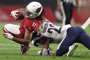 Cornerback Trumaine Johnson #22 of the Los Angeles Rams tackles wide receiver Larry Fitzgerald #11 of the Arizona Cardinals during the first half of the NFL game at the University of Phoenix Stadium on December 3, 2017 in Glendale, Arizona.