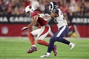 Cornerback Trumaine Johnson #22 of the Los Angeles Rams tackles wide receiver Larry Fitzgerald #11 of the Arizona Cardinals during the second half of the NFL game at the University of Phoenix Stadium on December 3, 2017 in Glendale, Arizona.