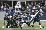 The Los Angeles Rams force the ball from the hands of tight end Jimmy Graham #88 of the Seattle Seahawks during the first quarter of the game at CenturyLink Field on December 17, 2017 in Seattle, Washington.