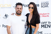Off the Menu Founder & CEO Lawrence Longo and Actress Shay Mitchell attend the Los Angeles Times Food Bowl Secret Burger Showdown at Wallis Annenberg Center for the Performing Arts on May 26, 2018 in Beverly Hills, California.