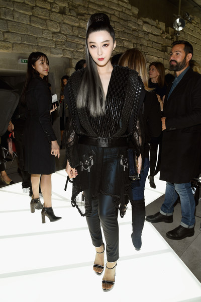 Fan Bingbing cut a strong silhouette in this beaded, sheer-bottom dress by Louis Vuitton during the brand's Spring 2018 show.