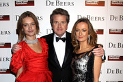 (L-R) Natalia Vodianova, De Beers CEO Francois Delage and Lucy Yeomans attend the Love Ball London at the Roundhouse on February 23, 2010 in London, England. The event, hosted by Russian model Natalia Vodianova, raised money for her charity The Naked Heart Foundation. The model teamed up with Harper's Bazaar and De Beers for the event which is similar to a previous ball held in Moscow.