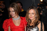 Natalia Vodianova (L) and Lucy Yeomans arrive at the Love Ball at The Roundhouse on February 23, 2010 in London, England.
