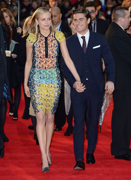 He holds hands with Taylor Schilling.