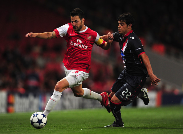 Luis Aguiar Cesc Fabregas of Arsenal battles with Luis Aguiar of Braga during the UEFA Champions League Group H match between Arsenal and SC Braga at the Emirates Stadium on September 15, 2010 in London, England.