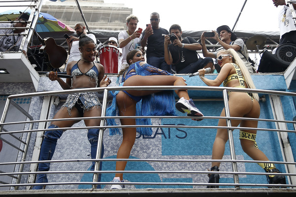 Bloco da Anitta [barechested,muscle,vehicle,fun,vacation,crowd,anitta,anitta and luisa sonza during the bloco,on,brazil,rebecca,rio de janeiro,bloco,anitta in downtown rio,boat,boating,vacation,water,crowd]