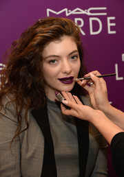 Lorde sported her signature long, voluminous waves at the launch of her MAC Cosmetics collection.