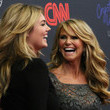 She laughs it up with Christie Brinkley.