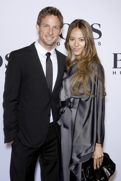 Formula 1 driver Jenson Button and girlfriend Jessica Michibata arrive at the BOSS Black Fashion Show during the Mercedes-Benz Fashion Week Berlin Autumn/Winter 2010 at the Hamburger Bahnhof on January 21, 2010 in Berlin, Germany.
