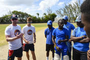 Paul Collingwood (L) and John Simpson (2L) of MCC chat with Combermere players during the MCC Champion County Training and School Visit at Combermere on March 26, 2018 in Bridgetown, Barbados.