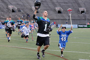 Joe Walters #1 of Team MLL leads the way against Team USA before the 2014 MLL All Star Game at Harvard Stadium on June 26, 2014 in Boston, Massachusetts.