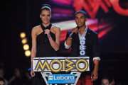 (EXCLUSIVE COVERAGE)  Jade Thompson and Lucien Laviscourt present the Best R&B/Soul Act on stage during the MOBO Awards 2011 at the SECC on October 5, 2011 in Glasgow, Scotland.