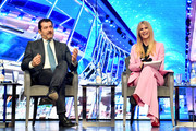 Gianni Onorato, CEO of MSC Cruises and Michelle Hunziker speak at the Media Briefing at the MSC Grandiosa Naming Ceremony on November 09, 2019 in Hamburg, Germany.