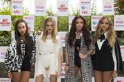 Leigh-Anne Pinnock, Perrie Edwards, Jesy Nelson, Jade Thirlwall of Little Mix pose for the media ahead of the MTV Crashes Plymouth concert at Plymouth Hoe on July 22, 2014 in Plymouth, England.