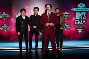 (L-R) Matthew Followill, Jared Followill, Will Ferrell as Anchorman's Ron Burgundy and Caleb Followill of Kings of Leon attend the MTV EMA's 2013 at the Ziggo Dome on November 10, 2013 in Amsterdam, Netherlands.
