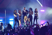 Fifth Harmony and Nick Cannon on stage during the 2014 MTV EMA Kick Off at the Klipsch Amphitheater on November 9, 2014 in Miami, Florida.