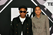 Pharrel Williams and Helen Lasichanh (R) attend the MTV EMA's 2015 at the Mediolanum Forum on October 25, 2015 in Milan, Italy.