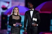 Manchester United's French football player Paul Pogba (R) and British actress Natalie Dormer (L) prepare to present an award during the 2017 MTV Europe Music Awards (EMA) at Wembley Arena in London on November 12, 2017. / AFP PHOTO / Ben STANSALL