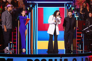 Rosalia accepts the Best Collaboration Award on stage from El Guincho on stage during the MTV EMAs 2019 at FIBES Conference and Exhibition Centre on November 03, 2019 in Seville, Spain.