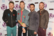 Coldplay with (L-R) Jonny Buckland, Chris Martin, Guy Berryman and Will Champion attend the MTV Europe Music Awards 2011 at the Odyssey Arena on November 6, 2011 in Belfast, Northern Ireland.
