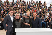 "(L-R) Nicholas Hoult, George Miller, Charlize Theron and Tom Hardy attend a photocall for ""Mad Max: Fury Road"" during the 68th annual Cannes Film Festival on May 14, 2015 in Cannes, France."