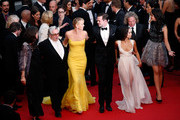"""(From L to R) Georges Miller, Charlize Theron, Nicholas Hoult and Zoe Kravitz attend Premiere of """"Mad Max: Fury Road"""" during the 68th annual Cannes Film Festival on May 14, 2015 in Cannes, France."""