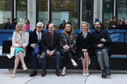 Mad Men cast members, Jon Hamm, January Jones, Elisabeth Moss, Christina Hendricks and John Slattery, with show creator, writer and executive producer Matthew Weiner and AMC president Charlie Collier pose with THE DRAPER BENCH, a semi-permanent art installation at the Time & Life Plaza, 1271 Avenue of the Americas, home of Sterling Cooper & Partners Advertising Agency in the iconic series at Time & Life Building on March 23, 2015 in New York City.