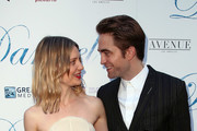 """Actors Mia Wasikowska (L) and Robert Pattinson attend Magnolia Pictures' """"Damsel"""" premiere at ArcLight Hollywood on June 13, 2018 in Hollywood, California."""
