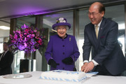 Queen Elizabeth II (L) smiles as Secretary-General of the International Maritime Organization (IMO) Kitack Lim (R) cuts the cake during a visit to the International Maritime Organization (IMO) to mark the 70th anniversary of its formation on March 6, 2018 in London, England.