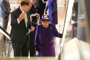 Queen Elizabeth II (R) talks with Secretary-General of the International Maritime Organization (IMO) Kitack Lim (L) as she visits the International Maritime Organization (IMO) to mark the 70th anniversary of its formation on March 6, 2018 in London, England.