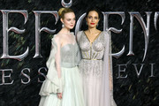 """Elle Fanning and Angelina Jolie attend the European premiere of """"Maleficent: Mistress of Evil"""" at Odeon IMAX Waterloo on October 09, 2019 in London, England."""
