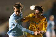 Jill Scott of Manchester City Women holds off a challenge from Isabell Bachor of LSK Kvinner during the UEFA Women's Champions League match between Manchester City Women and LSK Kvinner at The Academy Stadium on November 16, 2017 in Manchester, England.
