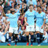Raheem Sterling John Stones Photos - Raheem Sterling of Manchester City celebrates after scoring his team's first goal with Kyle Walker of Manchester City and John Stones of Manchester City during the Premier League match between Manchester City and Newcastle United at Etihad Stadium on September 1, 2018 in Manchester, United Kingdom. - Manchester City vs. Newcastle United - Premier League