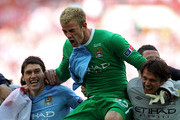 Joe Hart of Manchester City celebrates his team's victory at the end of the FA Cup sponsored by E.ON Final match between Manchester City and Stoke City at Wembley Stadium on May 14, 2011 in London, England.