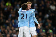 Kevin De Bruyne of Manchester City is congratulated by teammate David Silva after scoring his team's fourth goal during the Barclays Premier League match between Manchester City and Sunderland at the Etihad Stadium on December 26, 2015 in Manchester, England.