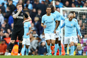 Alfie Mawson of Swansea City looks dejected following Manchester City's fifth goal during the Premier League match between Manchester City and Swansea City at Etihad Stadium on April 22, 2018 in Manchester, England.