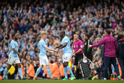 Kevin De Bruyne of Manchester City is substituted for Yaya Toure during the Premier League match between Manchester City and Swansea City at Etihad Stadium on April 22, 2018 in Manchester, England.