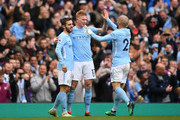 Kevin De Bruyne of Manchester City celebrates scoring his side's third goal with Bernardo Silva and David Silva during the Premier League match between Manchester City and Swansea City at Etihad Stadium on April 22, 2018 in Manchester, England.