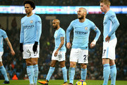 David Silva of Manchester City and Kevin De Bruyne of Manchester City look on during the Premier League match between Manchester City and Watford at Etihad Stadium on January 2, 2018 in Manchester, England.