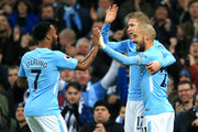 Raheem Sterling of Manchester City celebrates after scoring his sides first goal with David Silva of Manchester City and Kevin De Bruyne of Manchester City during the Premier League match between Manchester City and Watford at Etihad Stadium on January 2, 2018 in Manchester, England.