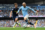 Luciano Vietto of Fulham and David Silva of Manchester City battle for the ball during the Premier League match between Manchester City and Fulham FC at Etihad Stadium on September 15, 2018 in Manchester, United Kingdom.