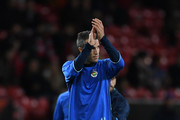 Robin van Persie of Fenerbahce applauds the fans as he warms up prior to the UEFA Europa League Group A match between Manchester United FC and Fenerbahce SK at Old Trafford on October 20, 2016 in Manchester, England.