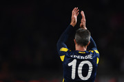 Robin van Persie of Fenerbahce applauds the fans following the final whistle during the UEFA Europa League Group A match between Manchester United FC and Fenerbahce SK at Old Trafford on October 20, 2016 in Manchester, England.
