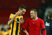 Tom Champion of Cambridge United speaks with Wayne Rooney of Manchester United after the FA Cup Fourth round replay match between Manchester United and Cambridge United at Old Trafford on February 3, 2015 in Manchester, England.