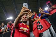 Juan Mata #8 of Manchester United takes photos with fans after International Champions Cup game against the Club America at the University of Phoenix Stadium on July 19, 2018 in Glendale, Arizona.